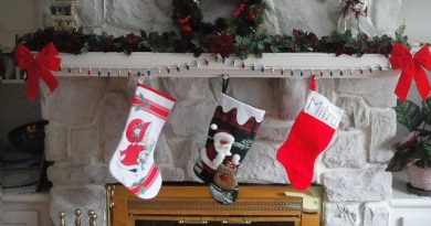 a fireplace with three christmas stockings