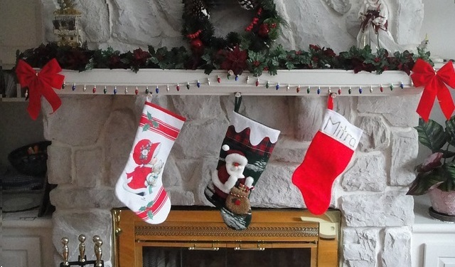a fireplace with three christmas stockings - Best Christmas Stockings