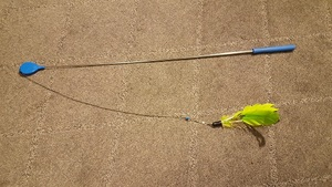 the air wand fully extended with the string all the way out