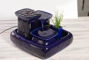 a blue ceramic fountain from miaustore